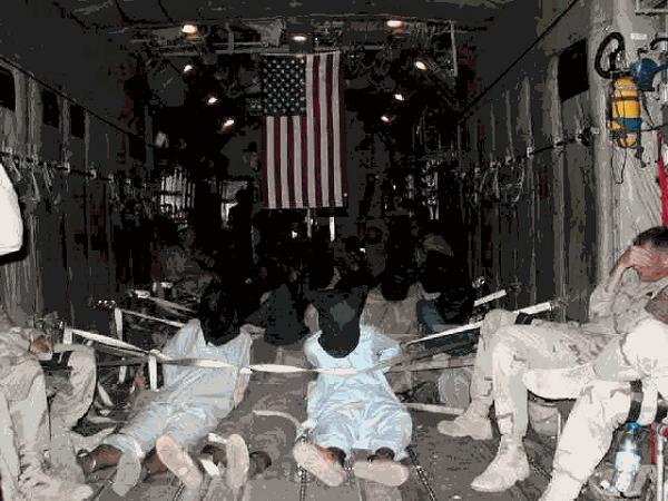 飛行機でグァンタナモ基地へ輸送されている途中の収監者たち。20201215大統領令が発令へ!選挙後45日以内に国家情報長官が外国の介入を報告・選挙詐欺師の全財産を没収