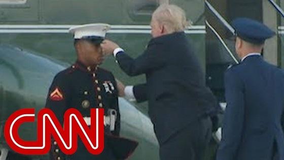 Trump stops to retrieve Marine's hat