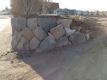 左の石積み修復後